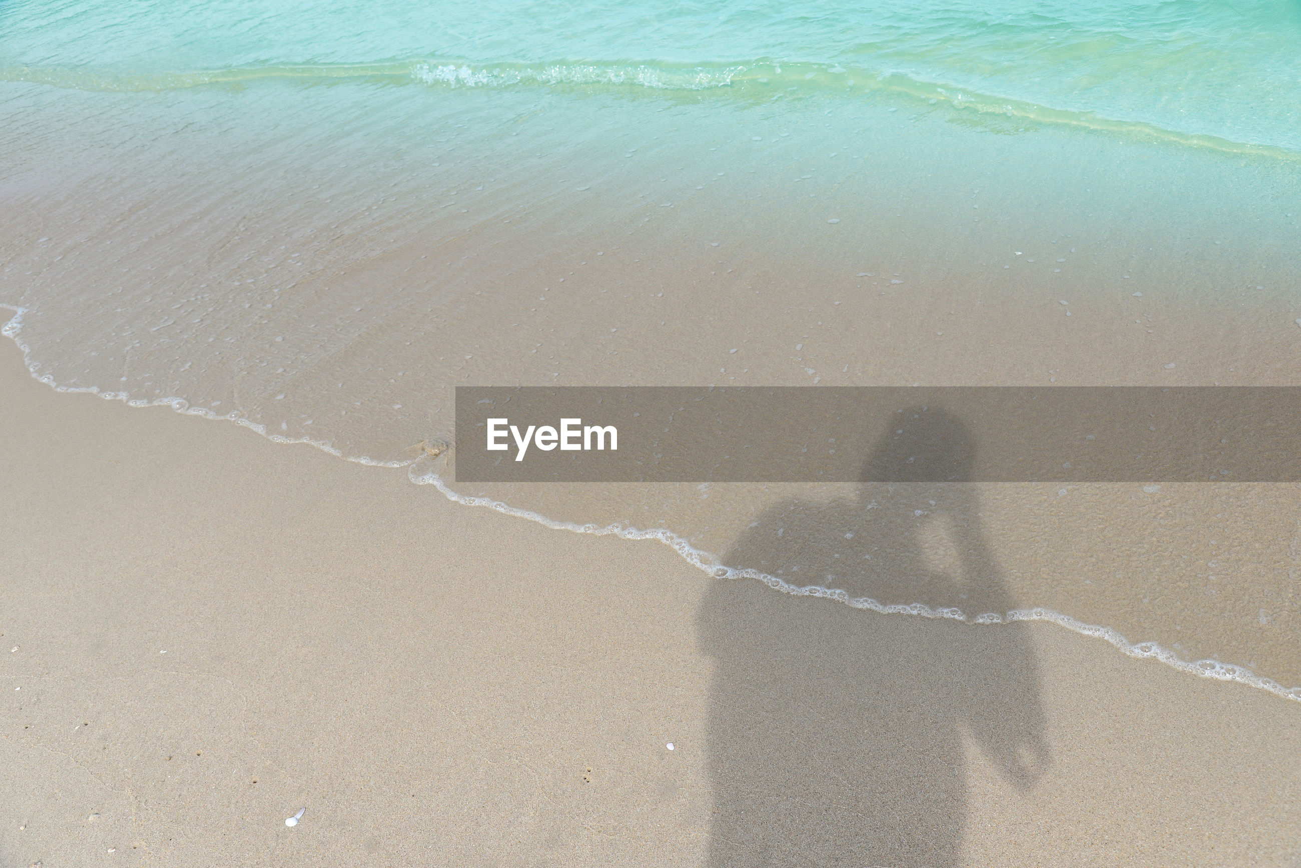 High angle view of shadow of person at beach