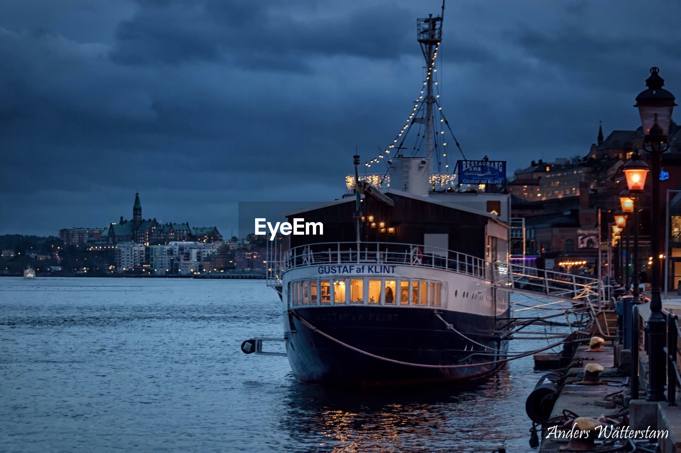 nautical vessel, water, architecture, transportation, sky, built structure, building exterior, mode of transport, boat, river, cloud - sky, waterfront, illuminated, city, moored, harbor, cloudy, cloud, travel, ship
