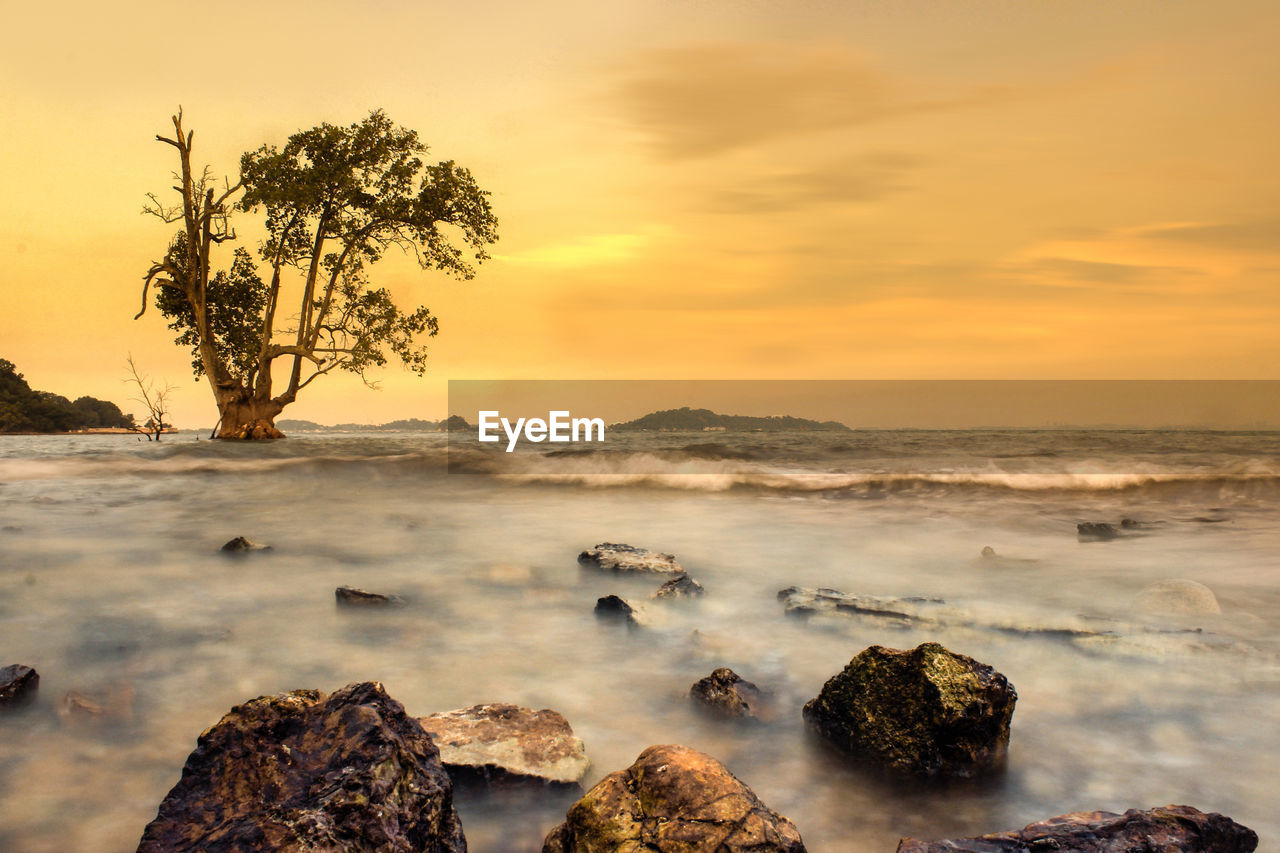 sunset, nature, beauty in nature, rock - object, scenics, sea, no people, sky, water, tranquility, tranquil scene, outdoors, long exposure, horizon over water, day