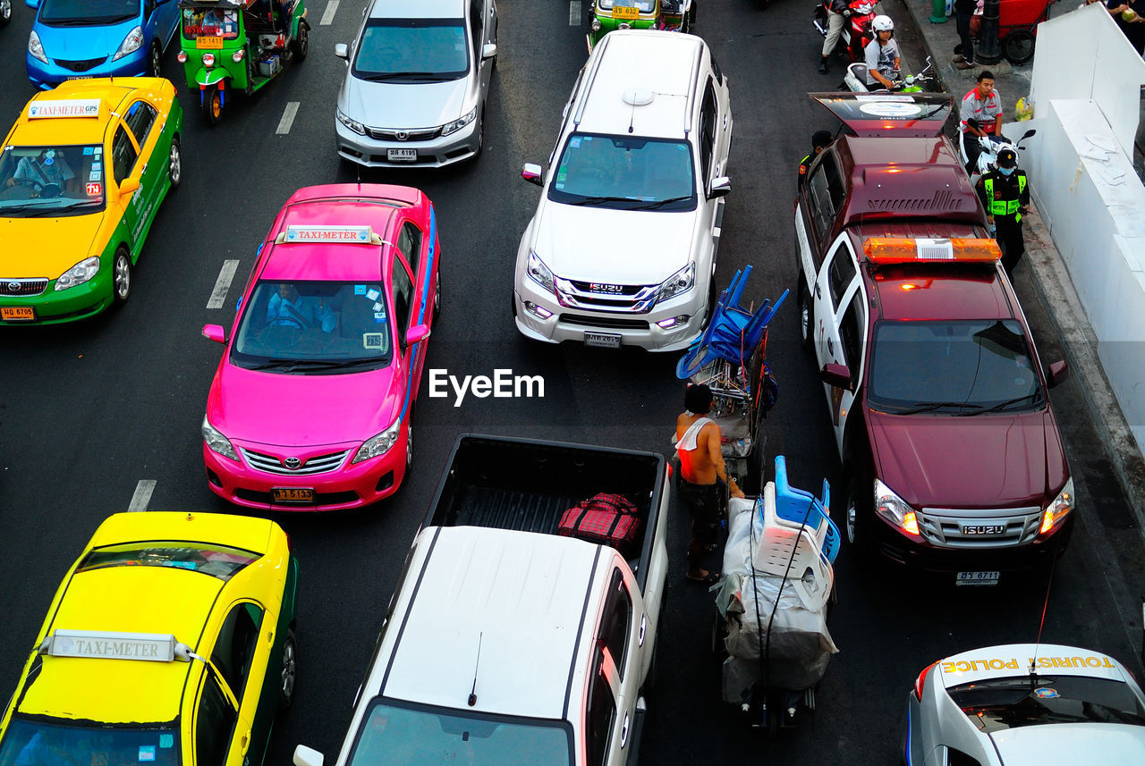 car, transportation, mode of transport, land vehicle, high angle view, outdoors, day, stationary, no people, multi colored, scooter
