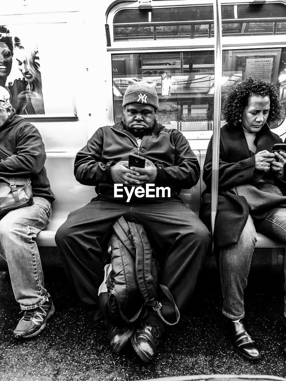 real people, sitting, lifestyles, men, full length, public transportation, train - vehicle, front view, train, rail transportation, people, casual clothing, mode of transportation, group of people, transportation, males, young men, adult, leisure activity, togetherness, subway train