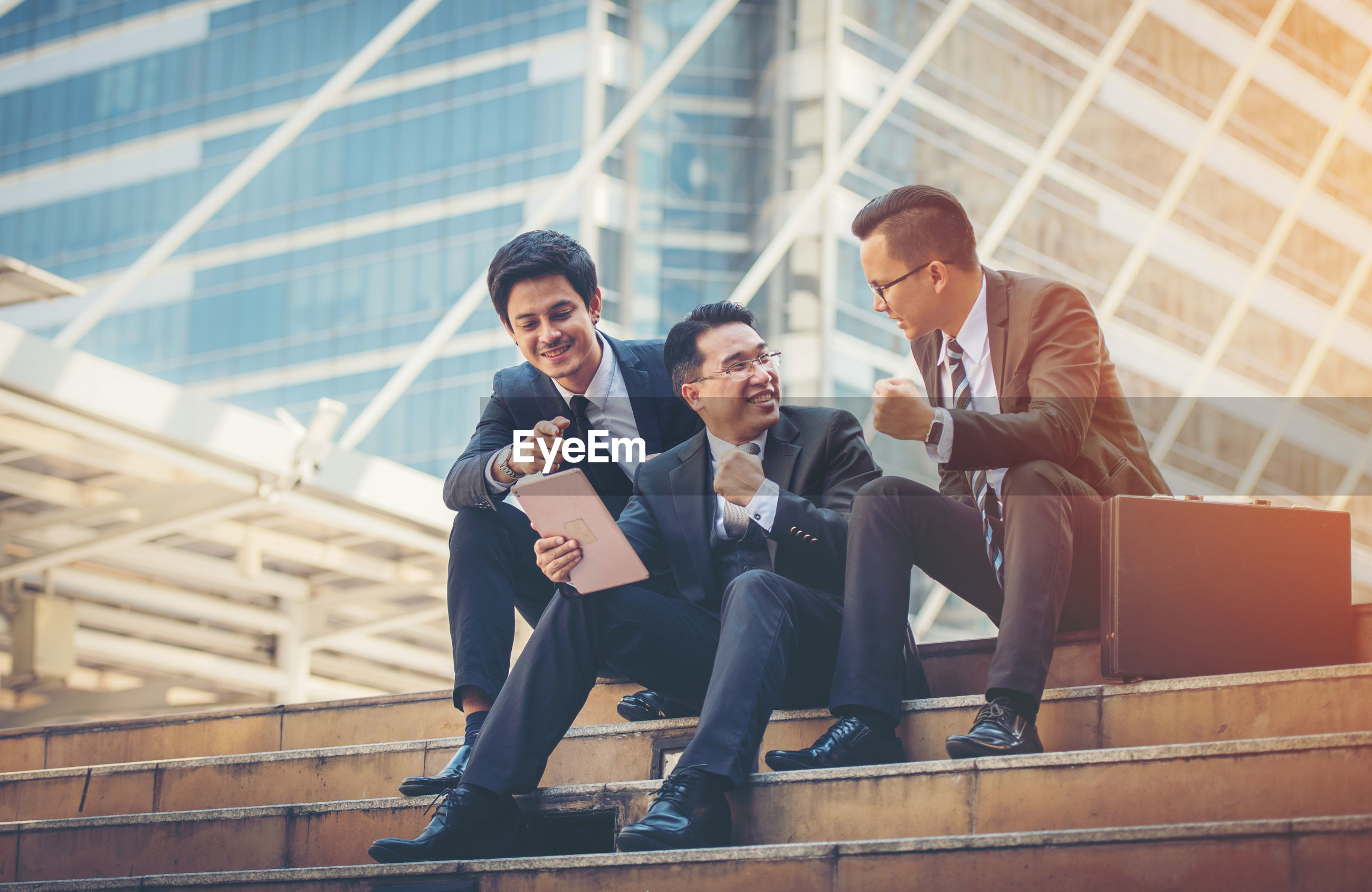 Low angle view of business colleagues on steps against office building