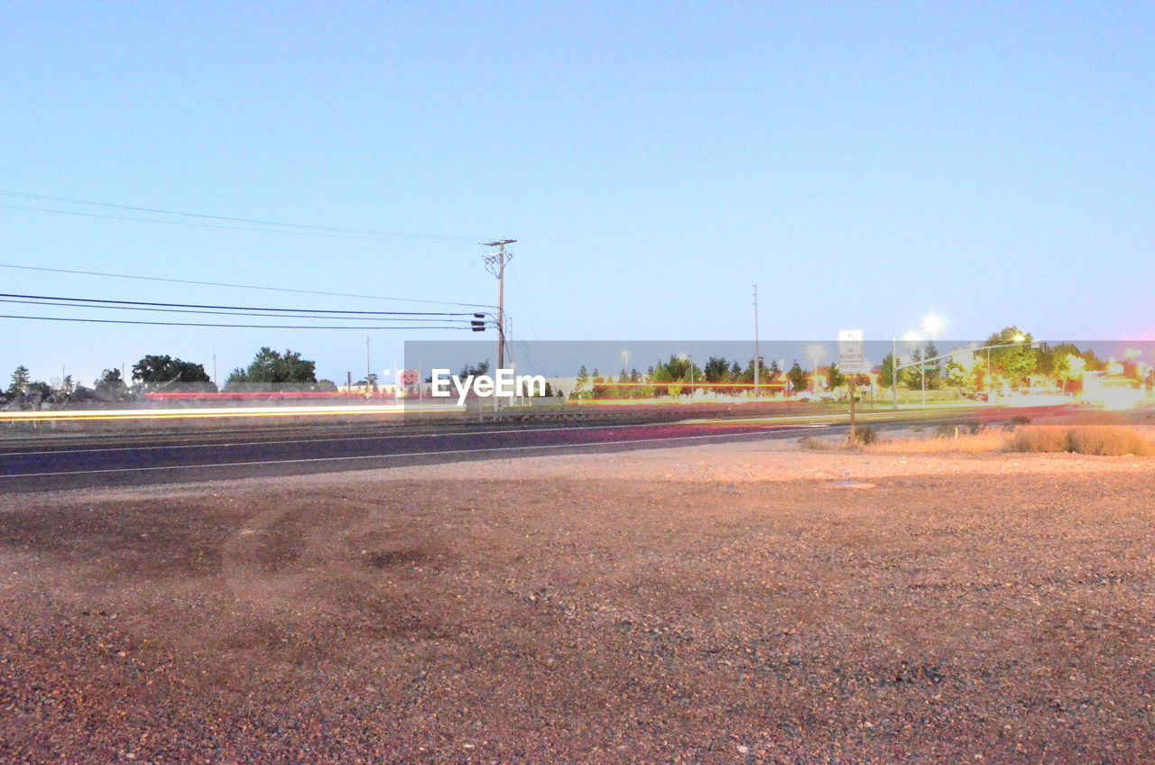 clear sky, electricity pylon, road, cable, no people, outdoors, nature, day, sky