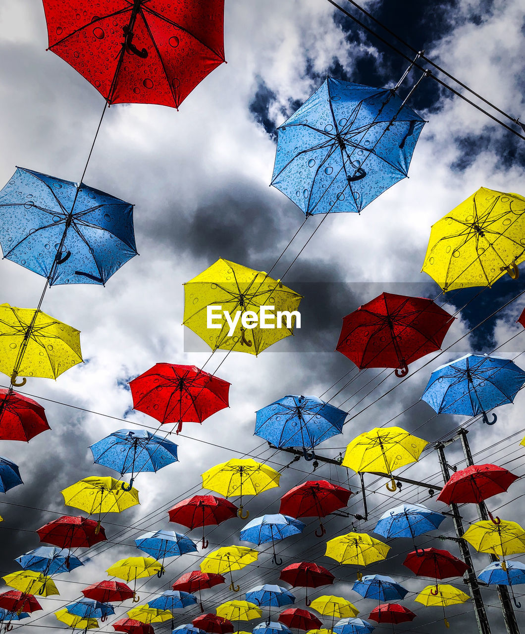 Multi Colored Sky Cloud - Sky Low Angle View Umbrella Yellow Nature Protection No People Day Plant Hanging Large Group Of Objects Decoration Outdoors Flower Tree Security Flowering Plant