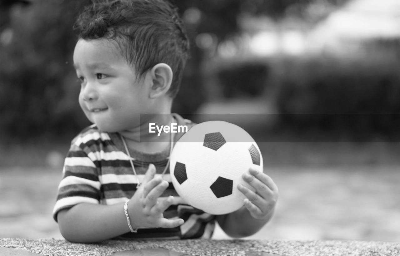 childhood, child, boys, males, men, one person, ball, real people, focus on foreground, soccer ball, soccer, lifestyles, team sport, casual clothing, leisure activity, sport, looking, cute, innocence
