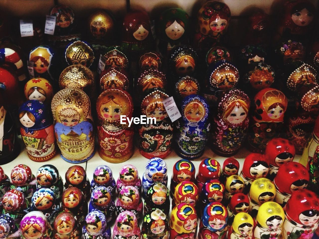 for sale, large group of objects, in a row, male likeness, multi colored, human representation, variation, art and craft, creativity, abundance, no people, retail, collection, indoors, choice, arrangement, full frame, figurine, day, backgrounds, close-up