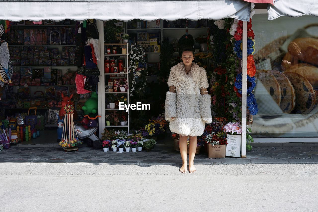 Portrait Of Woman Standing At Market