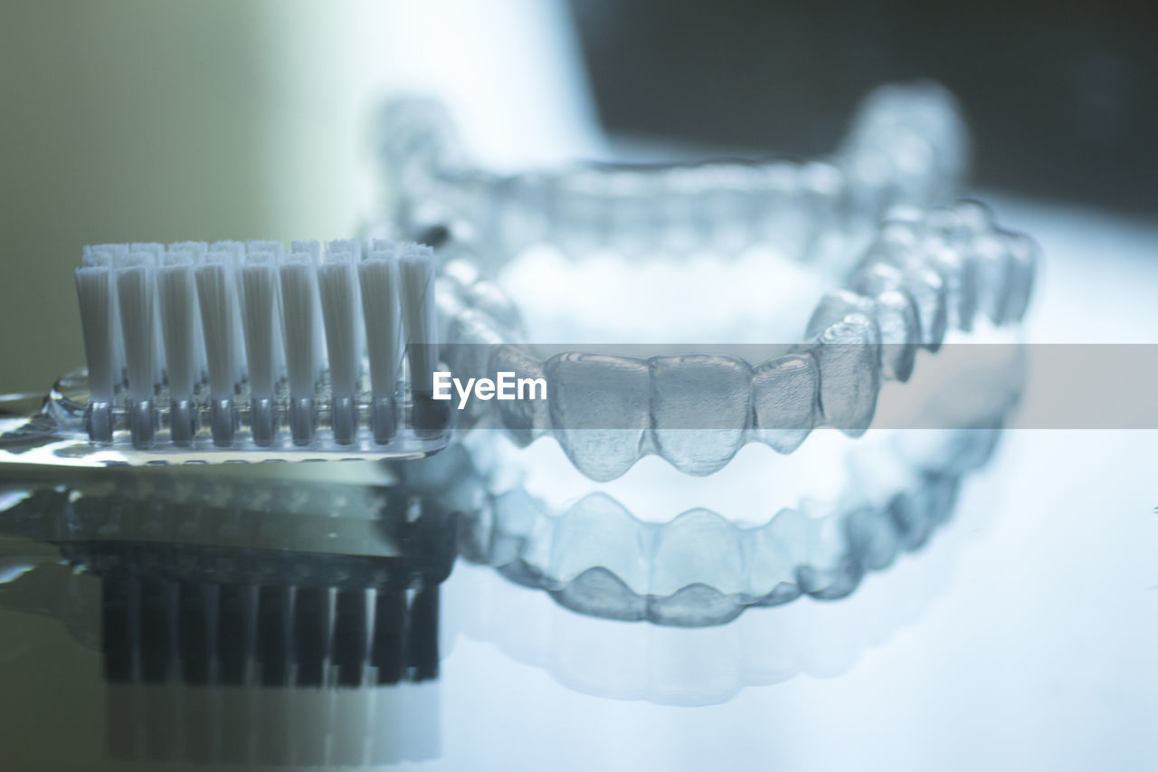 healthcare and medicine, dental health, indoors, close-up, hygiene, no people, still life, focus on foreground, selective focus, food and drink, reflection, table, medical equipment, metal, white color, wellbeing, food, freshness, pattern, care