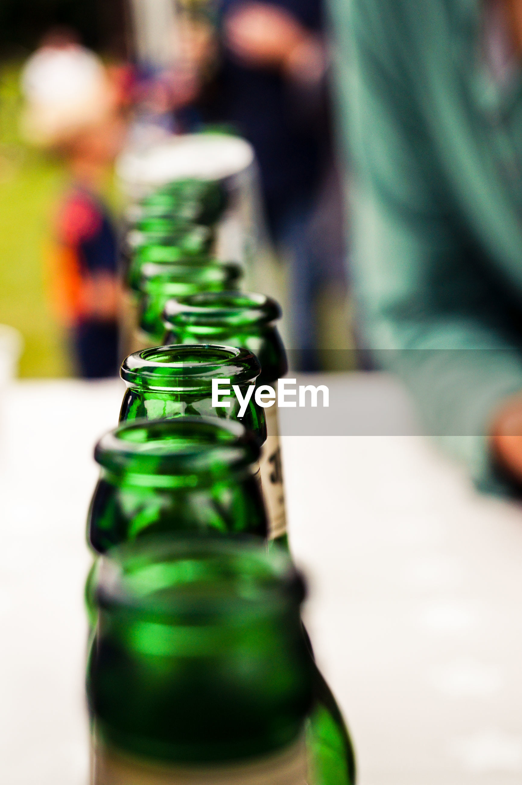 Close-up of beer bottles on table
