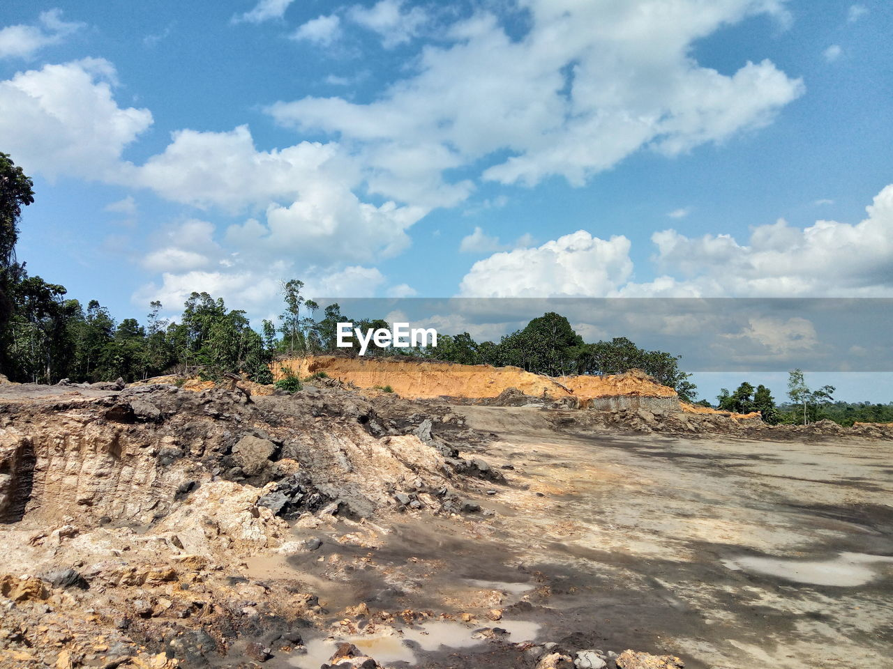 sky, cloud - sky, environment, nature, landscape, day, non-urban scene, scenics - nature, land, tree, tranquil scene, tranquility, no people, beauty in nature, plant, smoke - physical structure, outdoors, steam, environmental issues, heat - temperature, pollution, quarry