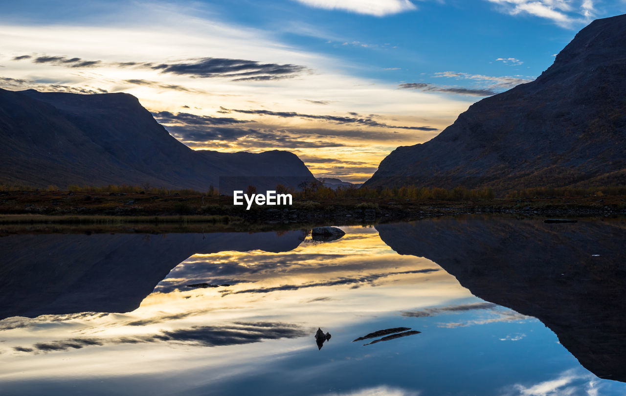 Scenic view of calm lake against mountain range in sweden