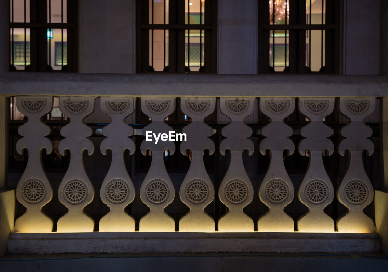 Illuminated railing of building at night