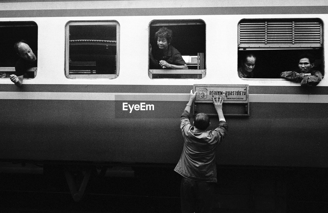 train - vehicle, transportation, real people, public transportation, men, mode of transport, lifestyles, women, one person, outdoors, day, people