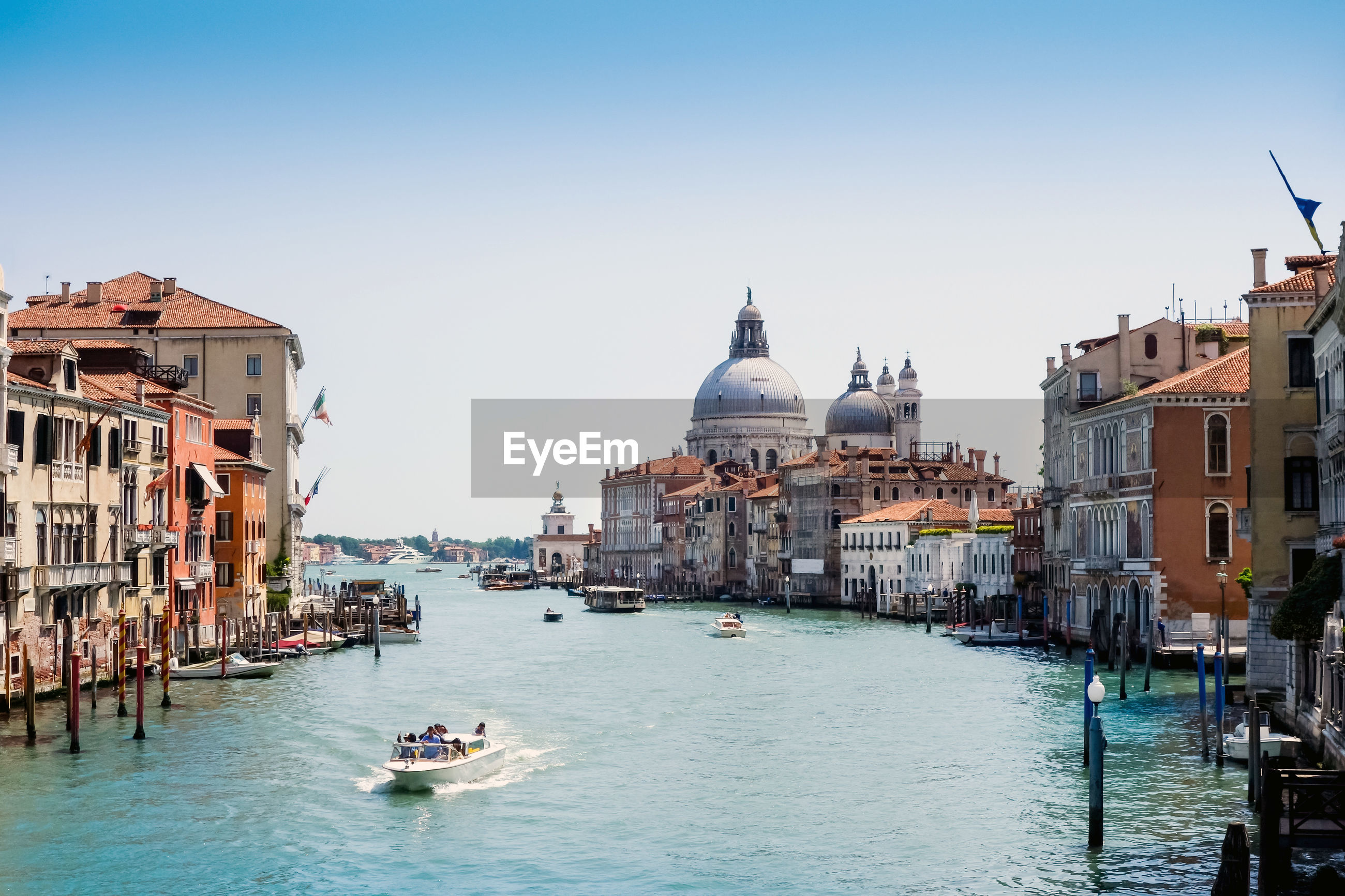 Grand canal and santa maria della salute against sky in city