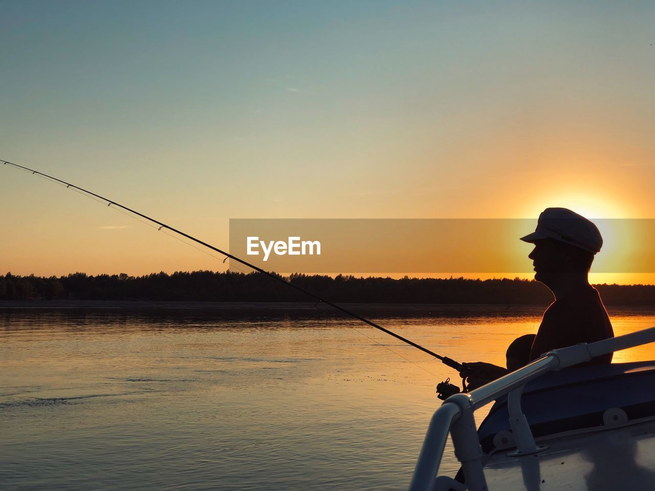water, sunset, sky, fishing, rod, fishing rod, one person, real people, orange color, silhouette, activity, scenics - nature, leisure activity, beauty in nature, nature, men, hat, lifestyles, outdoors
