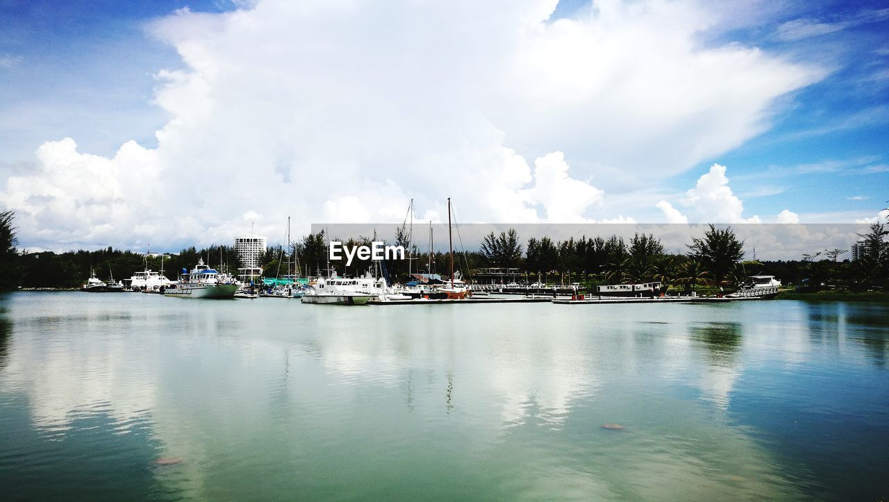 water, cloud - sky, sky, nautical vessel, reflection, waterfront, tranquil scene, no people, nature, tranquility, transportation, moored, scenics, outdoors, day, beauty in nature, tree, harbor, sea, mast, yacht