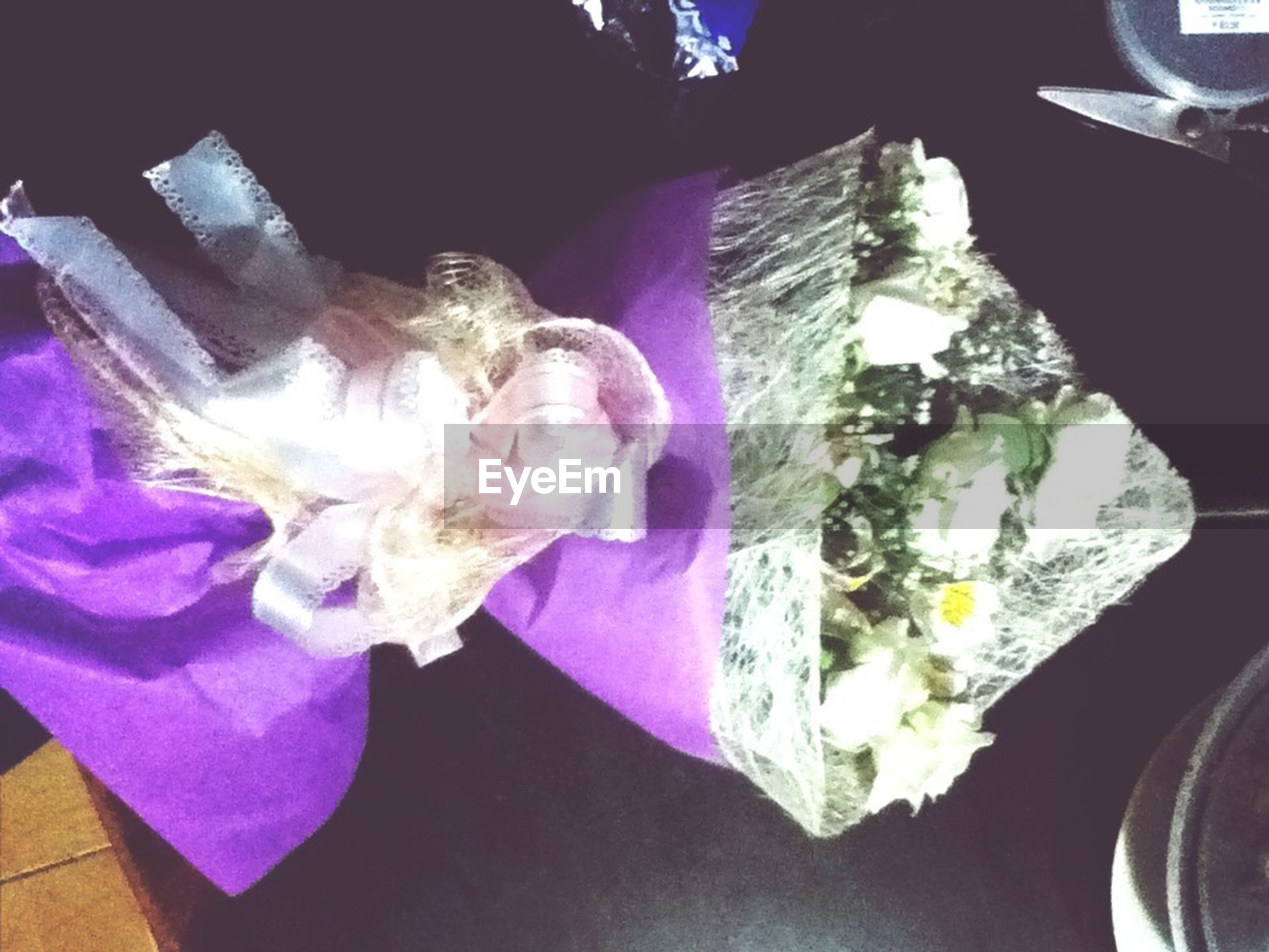 indoors, high angle view, close-up, blue, freshness, no people, day, still life, table, sunlight, transportation, flower, water, reflection, part of, car, purple, mode of transport, glass - material