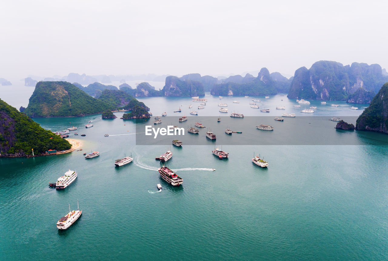 water, nautical vessel, high angle view, scenics, nature, sea, mountain, transportation, beauty in nature, outdoors, waterfront, day, sky, no people