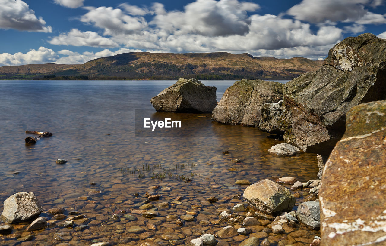 sky, water, rock, cloud - sky, beauty in nature, solid, nature, rock - object, scenics - nature, sea, mountain, tranquility, tranquil scene, no people, environment, day, land, outdoors, stone, shallow