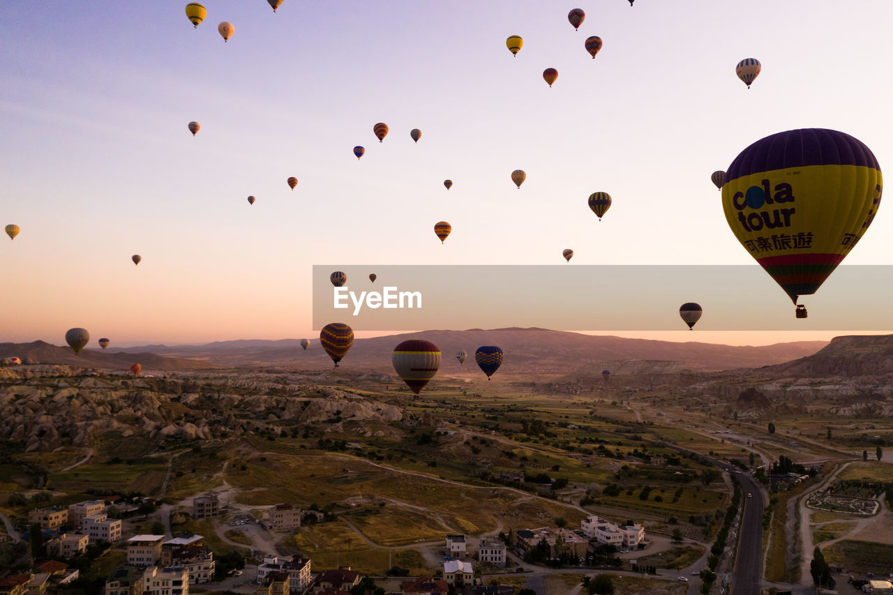 balloon, hot air balloon, air vehicle, transportation, mid-air, flying, sky, mode of transportation, nature, adventure, sunset, travel, environment, ballooning festival, landscape, architecture, no people, travel destinations, beauty in nature, mountain, outdoors