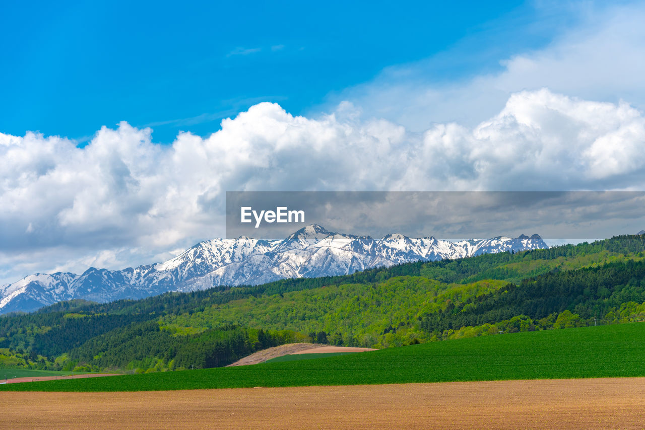sky, cloud - sky, scenics - nature, beauty in nature, mountain, tranquil scene, landscape, environment, tranquility, land, mountain range, plant, nature, non-urban scene, no people, day, green color, tree, field, idyllic, snowcapped mountain, mountain peak