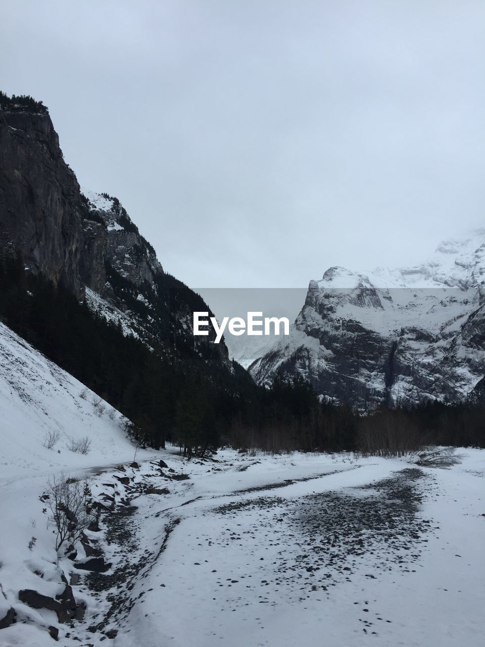 snow, winter, cold temperature, mountain, beauty in nature, sky, scenics - nature, tranquil scene, tranquility, nature, no people, environment, snowcapped mountain, day, mountain range, non-urban scene, landscape, cloud - sky, frozen, outdoors, mountain peak