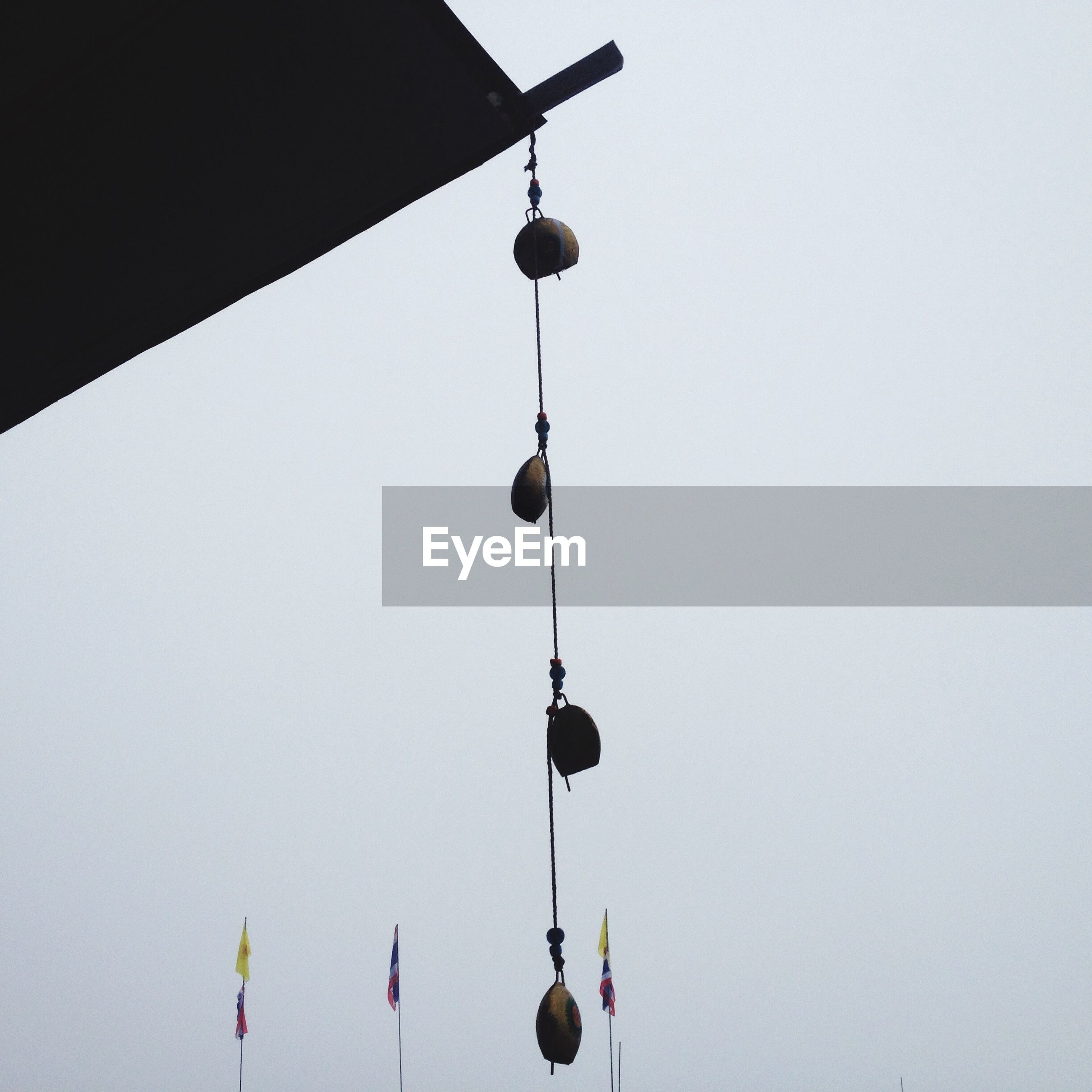 hanging, low angle view, clear sky, no people, day, outdoors, sky