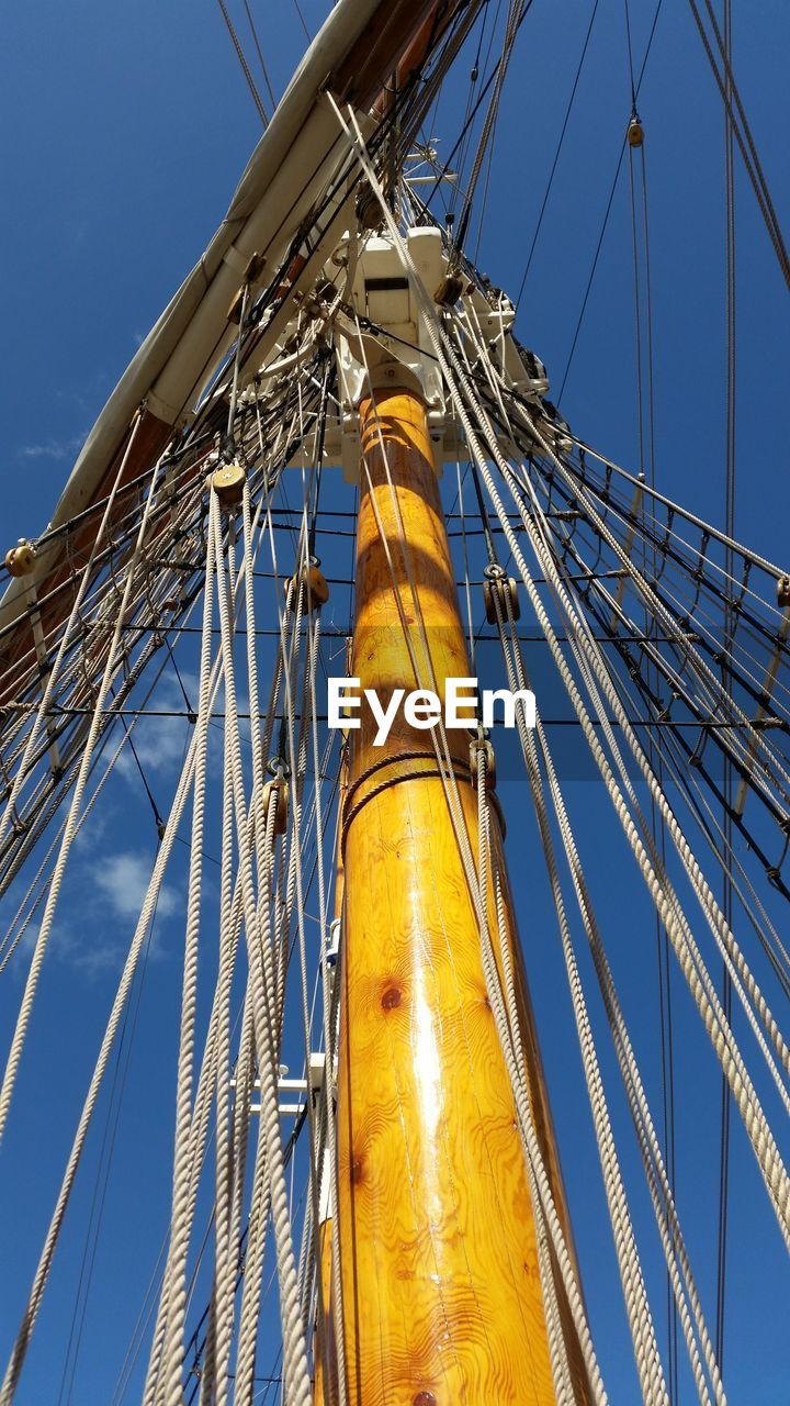 low angle view, sky, metal, nature, nautical vessel, no people, mast, day, sailboat, clear sky, pole, outdoors, yellow, rope, industry, blue, architecture, sunlight, fuel and power generation, transportation, rigging