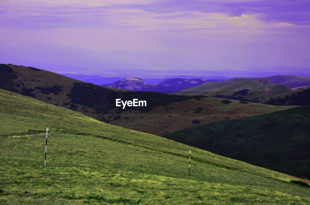 Majestic View Of Mountains Against Purple Sky