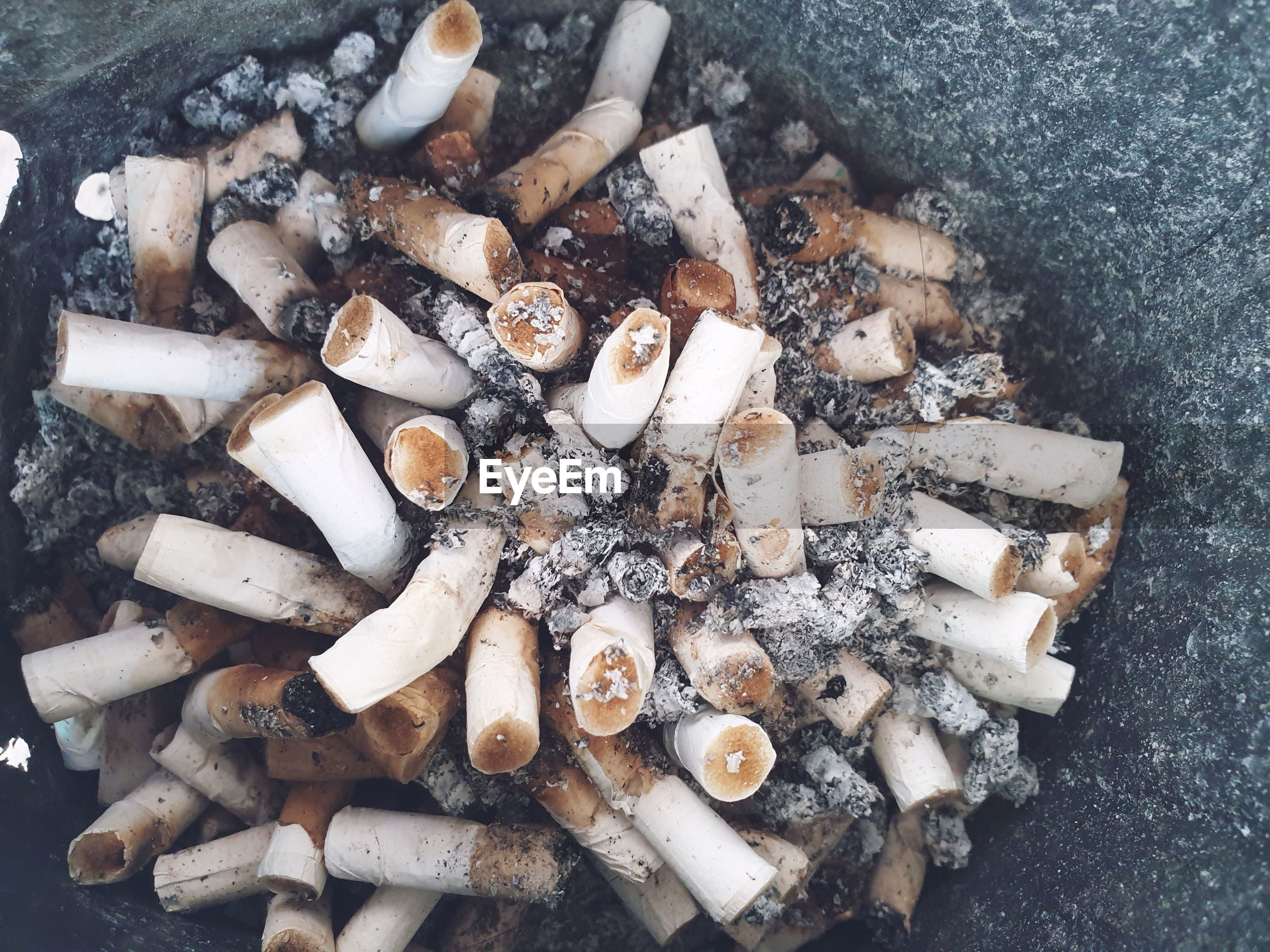 High angle view of cigarette butts