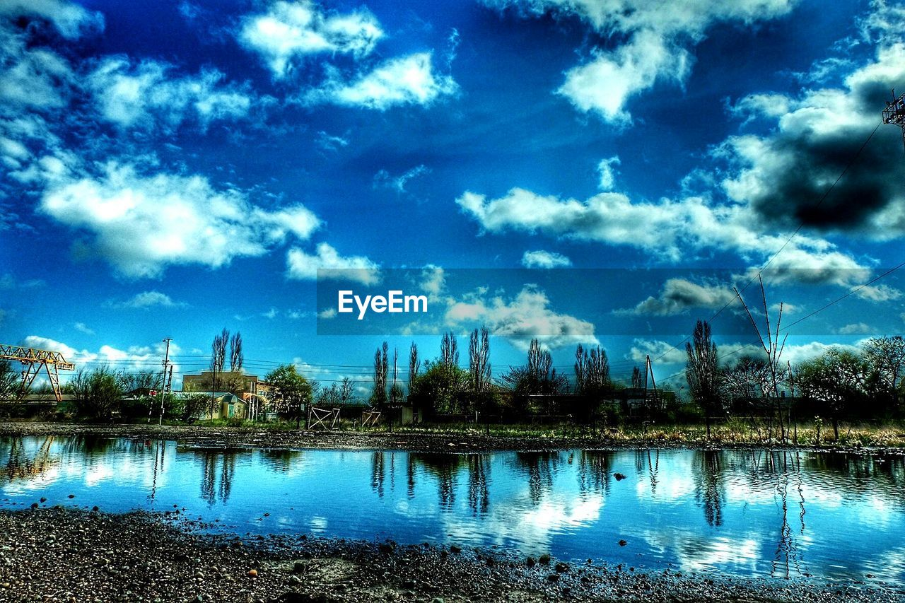 reflection, sky, water, cloud - sky, no people, tree, nature, outdoors, built structure, architecture, blue, day, lake, travel destinations, beauty in nature, building exterior, city