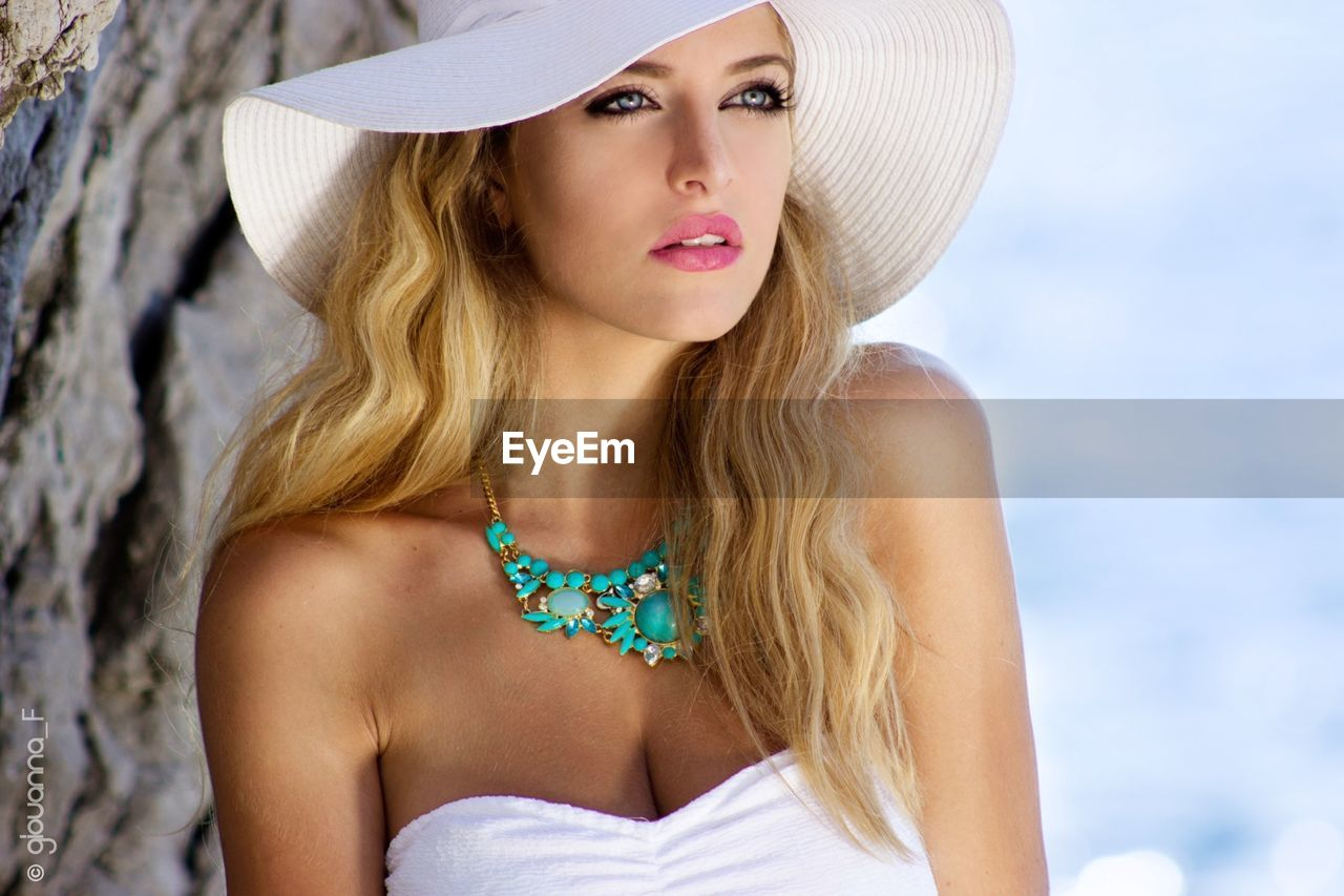 young adult, young women, real people, beautiful woman, fashion, one person, beauty, outdoors, leisure activity, sun hat, fashion model, day, close-up, women, water, standing, lifestyles, beautiful people, beauty in nature, blond hair, sea, portrait, nature