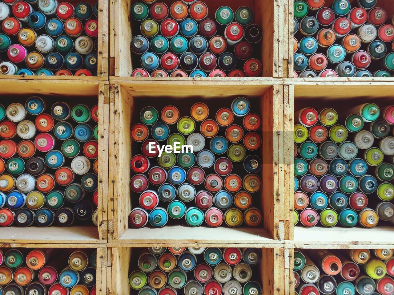 Full Frame Shot Of Colorful Thread Spools In Wooden Containers