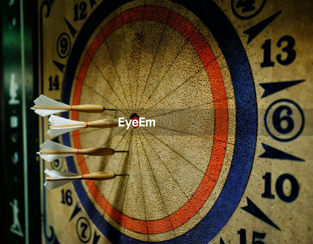 Close-up of dartboards with darts