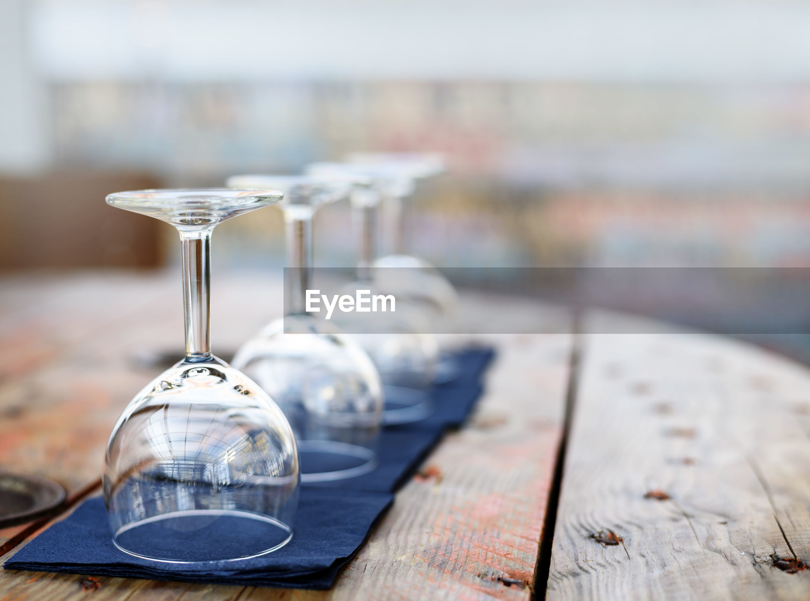 Close-up of wineglasses on wooden table