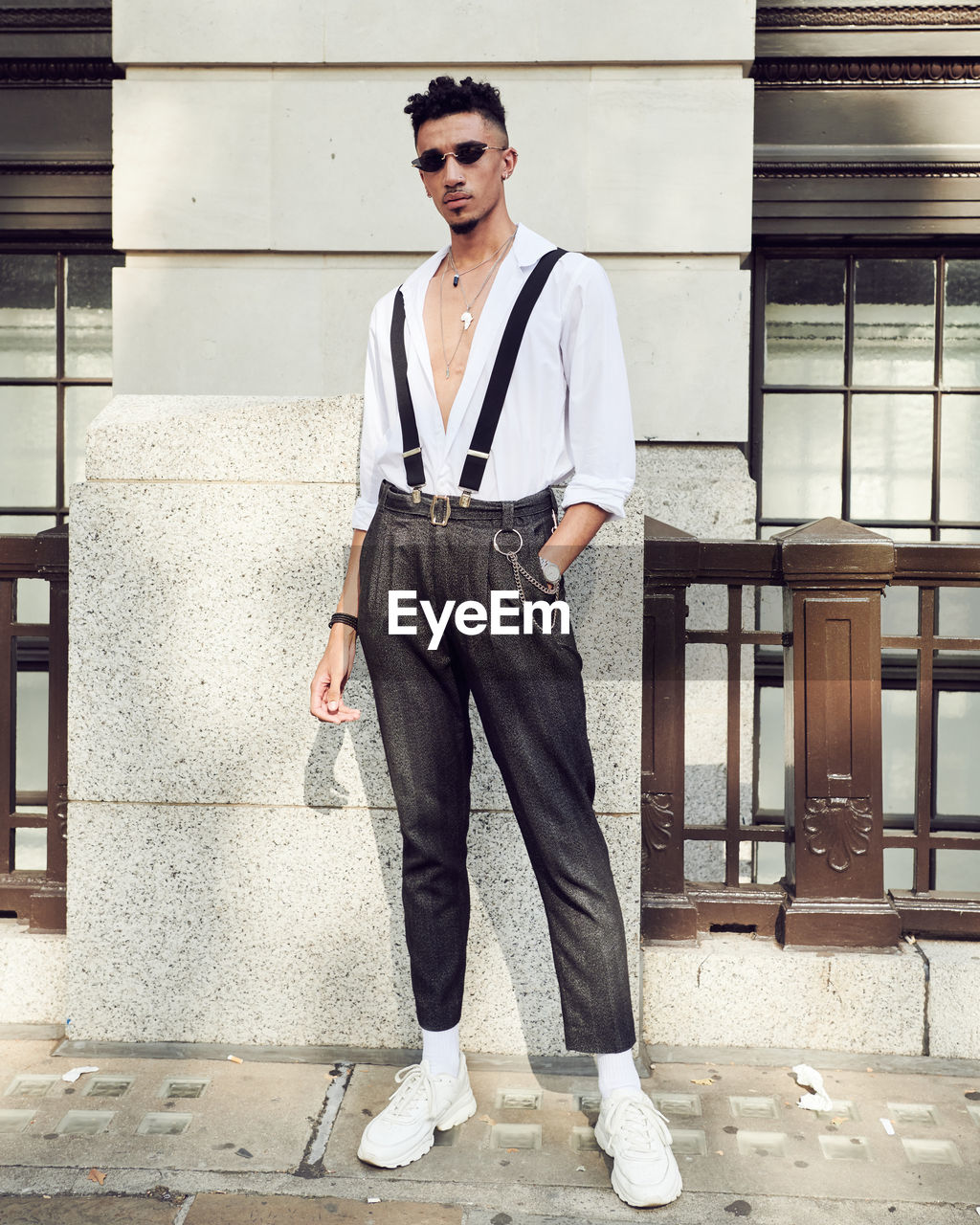 young men, young adult, one person, full length, standing, portrait, looking at camera, architecture, real people, beautiful people, front view, fashion, casual clothing, building exterior, built structure, handsome, glasses, confidence, outdoors, jeans