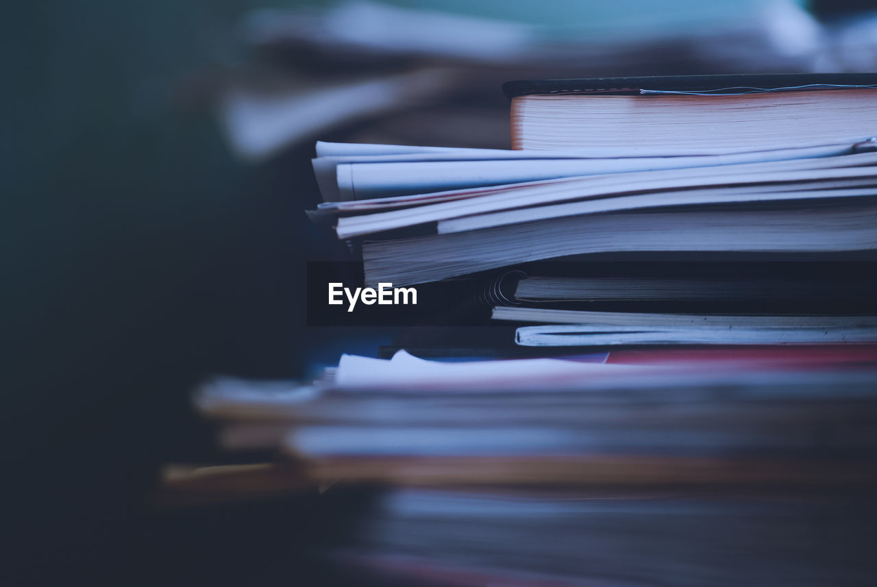 stack, publication, book, still life, paper, selective focus, indoors, no people, close-up, education, table, focus on foreground, large group of objects, literature, wisdom, expertise, learning, document, page, open