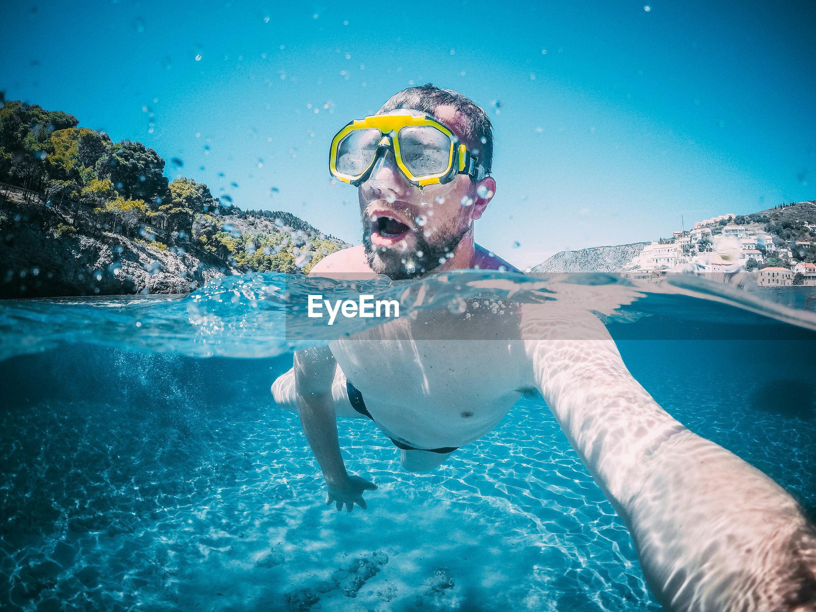 Man in swimming in sea