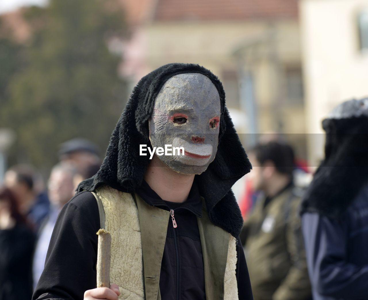 Close-up of man wearing mask at carnival