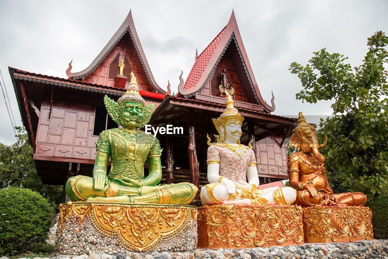 built structure, art and craft, sculpture, representation, architecture, statue, religion, belief, building, creativity, spirituality, human representation, place of worship, no people, male likeness, sky, plant, day, building exterior, outdoors, idol, ornate, shrine