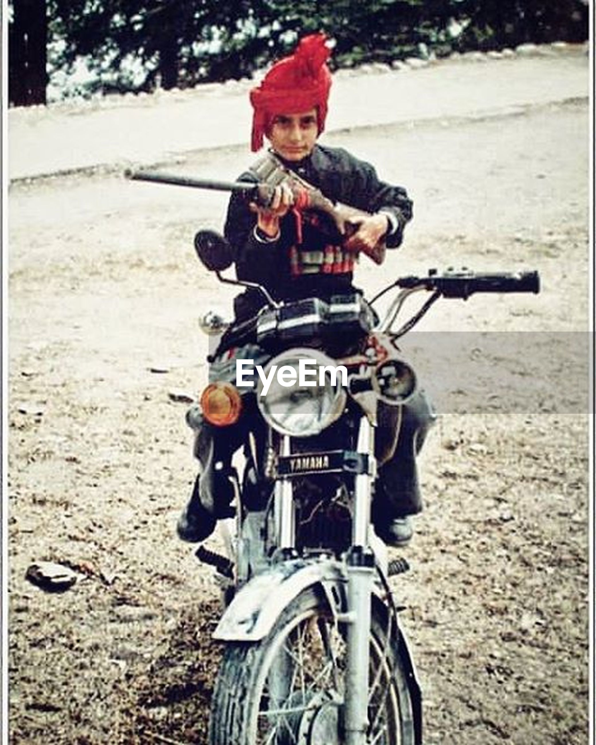 mode of transport, transportation, land vehicle, bicycle, helmet, stationary, day, motorcycle, outdoors, travel, parking, headwear, sunlight, front view, full length, field, equipment, riding