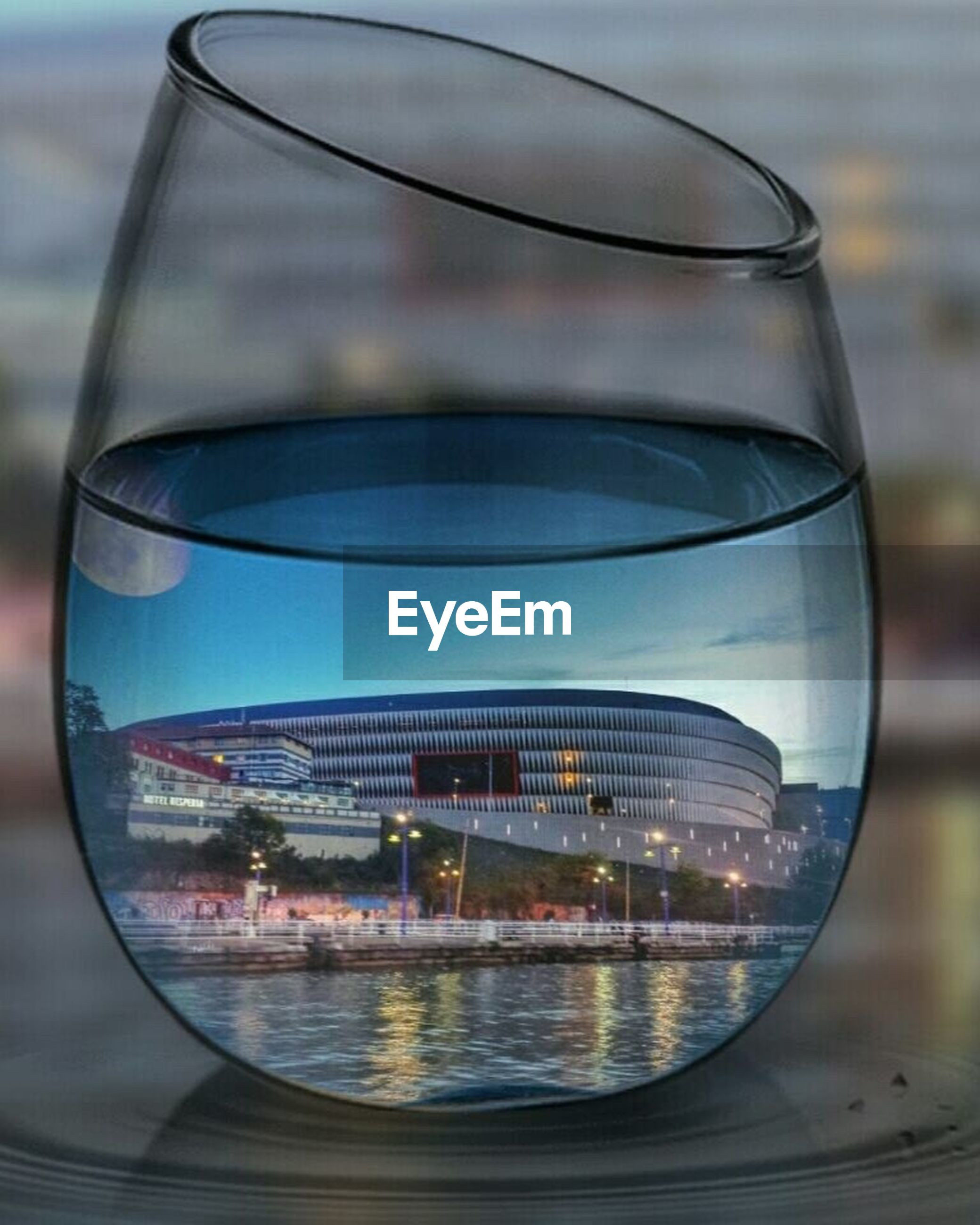 glass - material, reflection, transparent, indoors, close-up, sky, circle, window, water, no people, transportation, modern, day, focus on foreground, part of, geometric shape, mode of transport, air vehicle, airplane