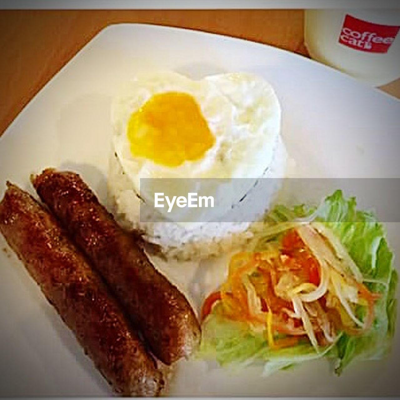 egg, food and drink, food, fried egg, breakfast, ready-to-eat, plate, healthy eating, egg yolk, no people, bacon, fried, high angle view, indoors, sausage, freshness, sunny side up, processed meat, close-up, day