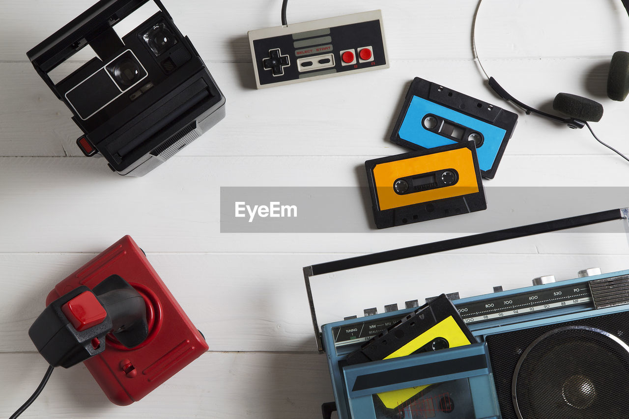 Directly Above Shot Of Boom Box And Audio Cassettes On Table