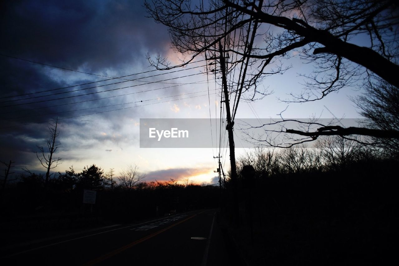 silhouette, sky, tree, bare tree, sunset, cable, no people, nature, power line, cloud - sky, power supply, electricity, transportation, electricity pylon, railroad track, rail transportation, outdoors, scenics, beauty in nature, branch, day