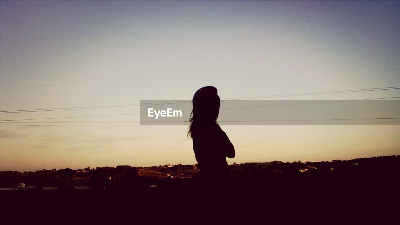 silhouette, sunset, one person, clear sky, real people, full length, standing, lifestyles, sky, outdoors, nature, day, people