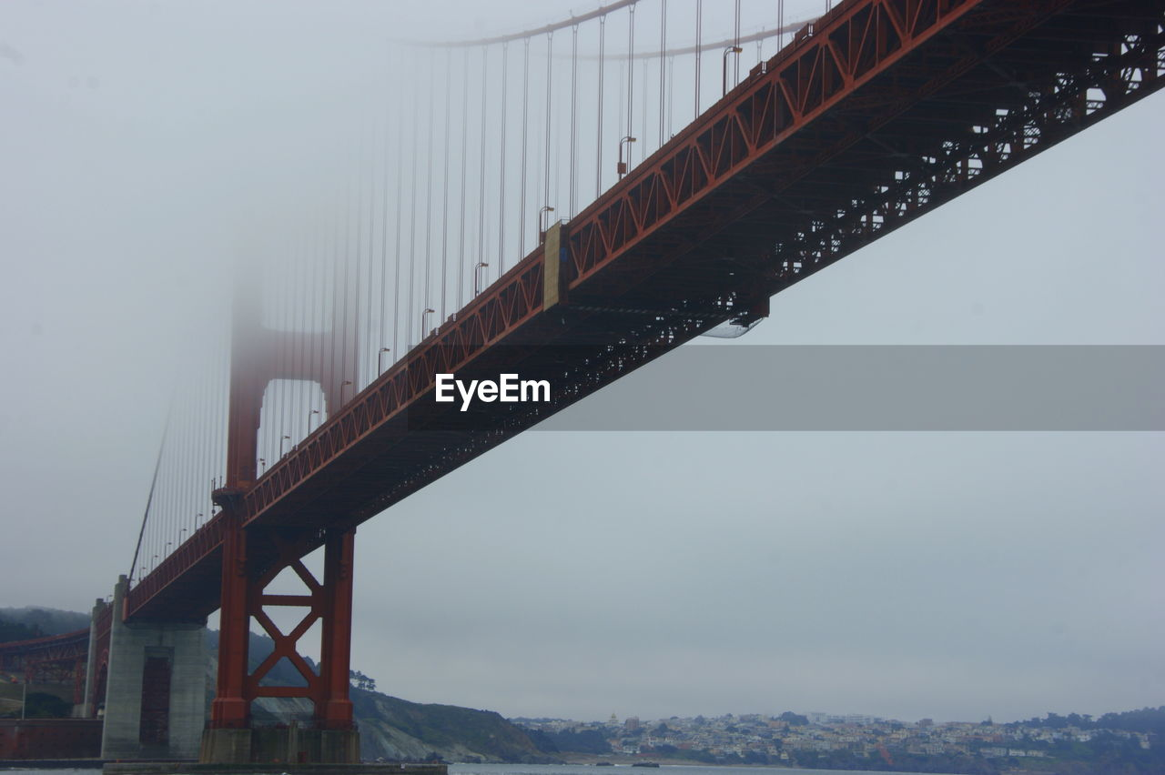 Low angle view of golden gate bridge against sky