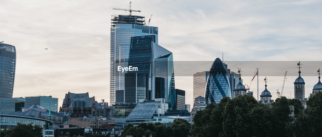 Panoramic view of skyscrapers and modern office buildings of the city of london, uk.