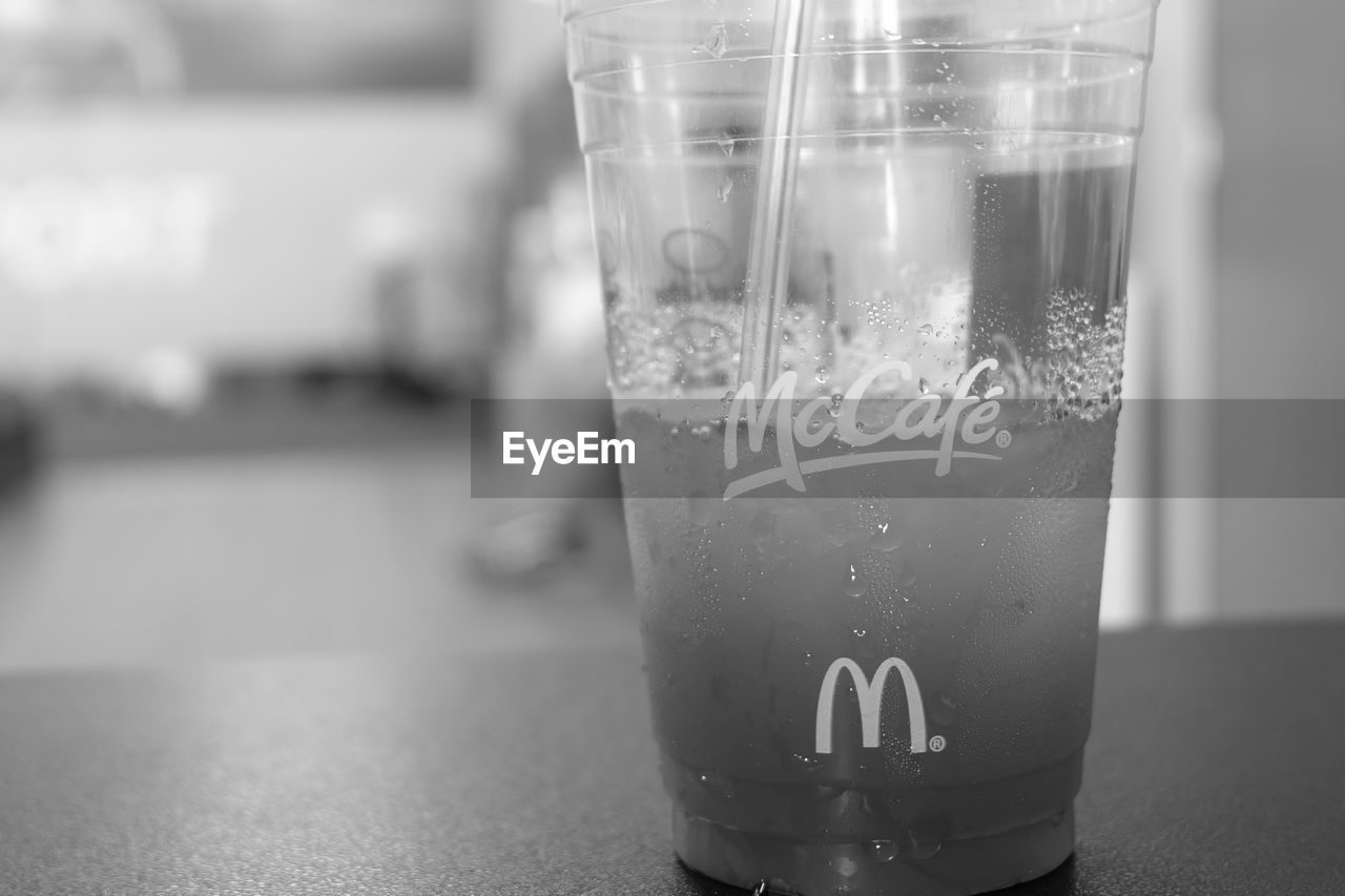 focus on foreground, drink, text, close-up, indoors, refreshment, table, drinking glass, no people, freshness, water, day