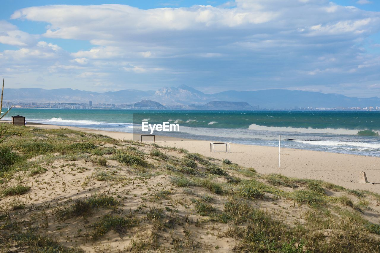 water, beach, land, sea, sky, cloud - sky, sand, nature, beauty in nature, scenics - nature, mountain, plant, outdoors, sport, no people, tranquility, day, environment, tranquil scene